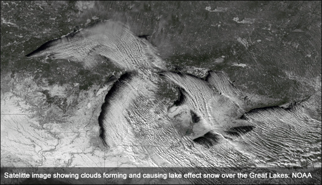 A satellite image of snow and clouds over the Great Lakes Basin